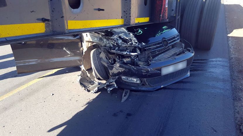 Woman crushes her car under the truck and survives