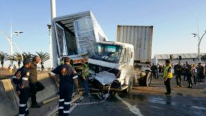 Two trucks and a car crash leaving 4 people seriously injured