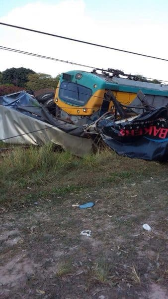 Train ploughs into truck and derails