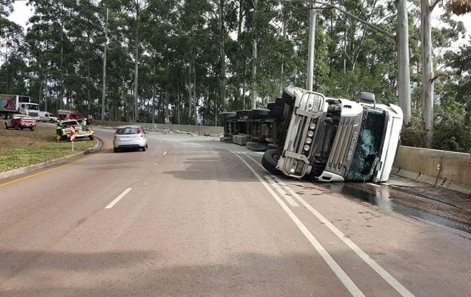 Truck driver escapes death as truck rolls