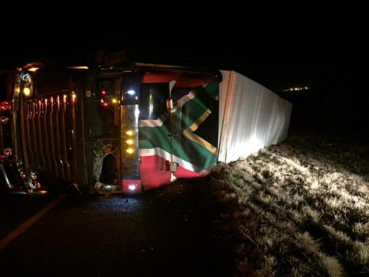 TRUCK OVERTURNS INJURING TWO