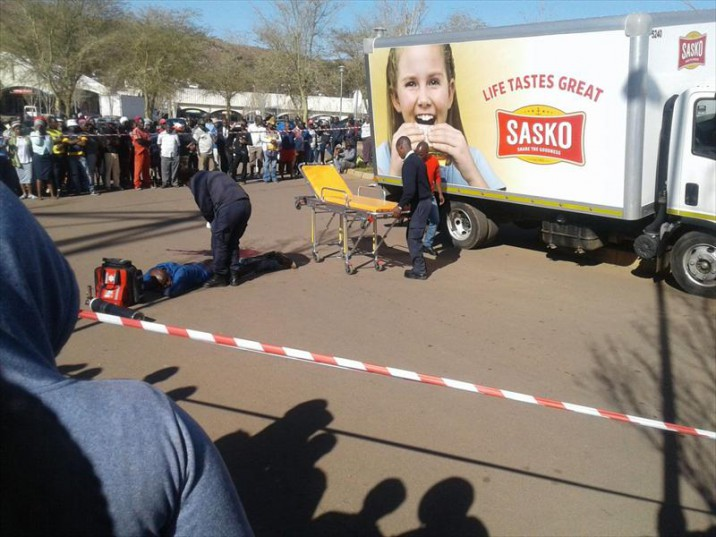 TRUCK DRIVER SHOOTS ROBBER IN BUTTOCKS