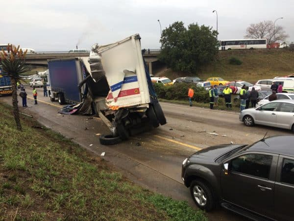 TWO TRUCKS AND A CAR CRASH LEAVES FOUR INJURED