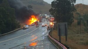 Trucks collide, burst into flames killing one, another critical