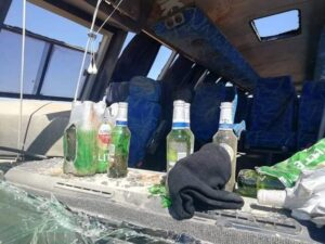 Police probe bus driver in fatal crash after he was seen looting beer