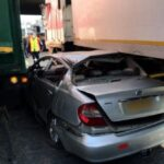 Car squashed between trucks in Germiston collision