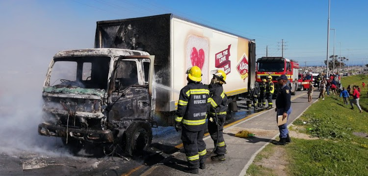 Assistant injured as truck is petrol bombed in Cape Town