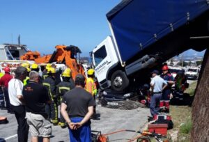 Watch: Truck lands on top of car in PE accident
