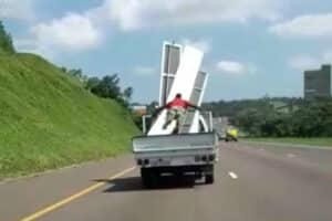 WATCH | Man nearly flies off back of truck on busy Durban freeway