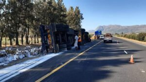 Pics: Truck overturns killing bystander, a fruit seller on N1 in Paarl