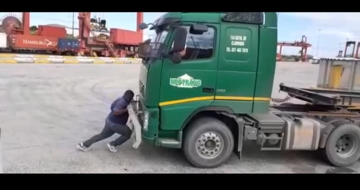 Watch: Hulk truck driver shows off his power by pushing truck all by himself