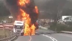 Tragic moment man filmed throwing himself onto burning truck after losing wife in crash