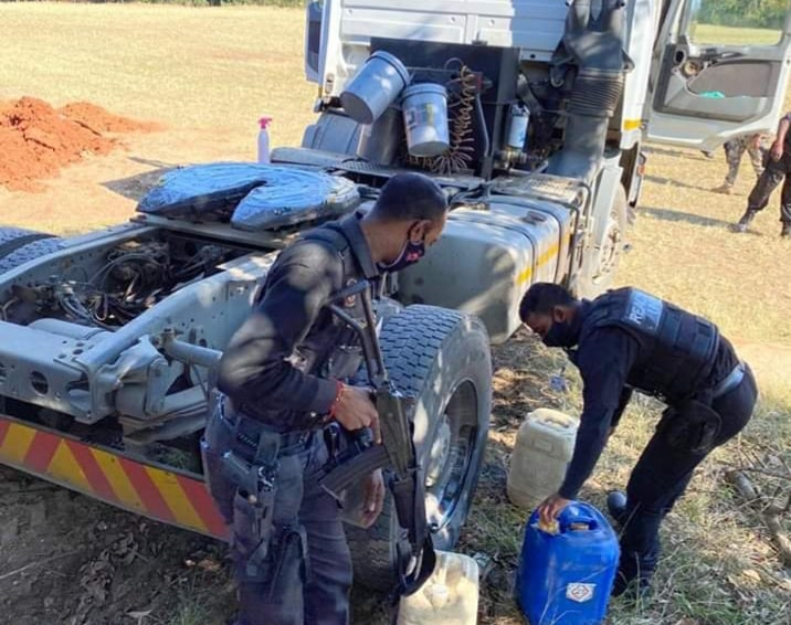 Two men caught red-handed stealing diesel from truck in Durban