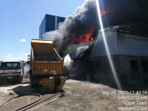 Watch: JRE Transport factory burns down destroying trucks injuring one