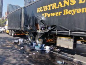 truck bulldosing looters' car in pretoria