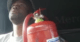 truck driver with fire extinguisher