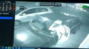 thief removing car windscreen to steal