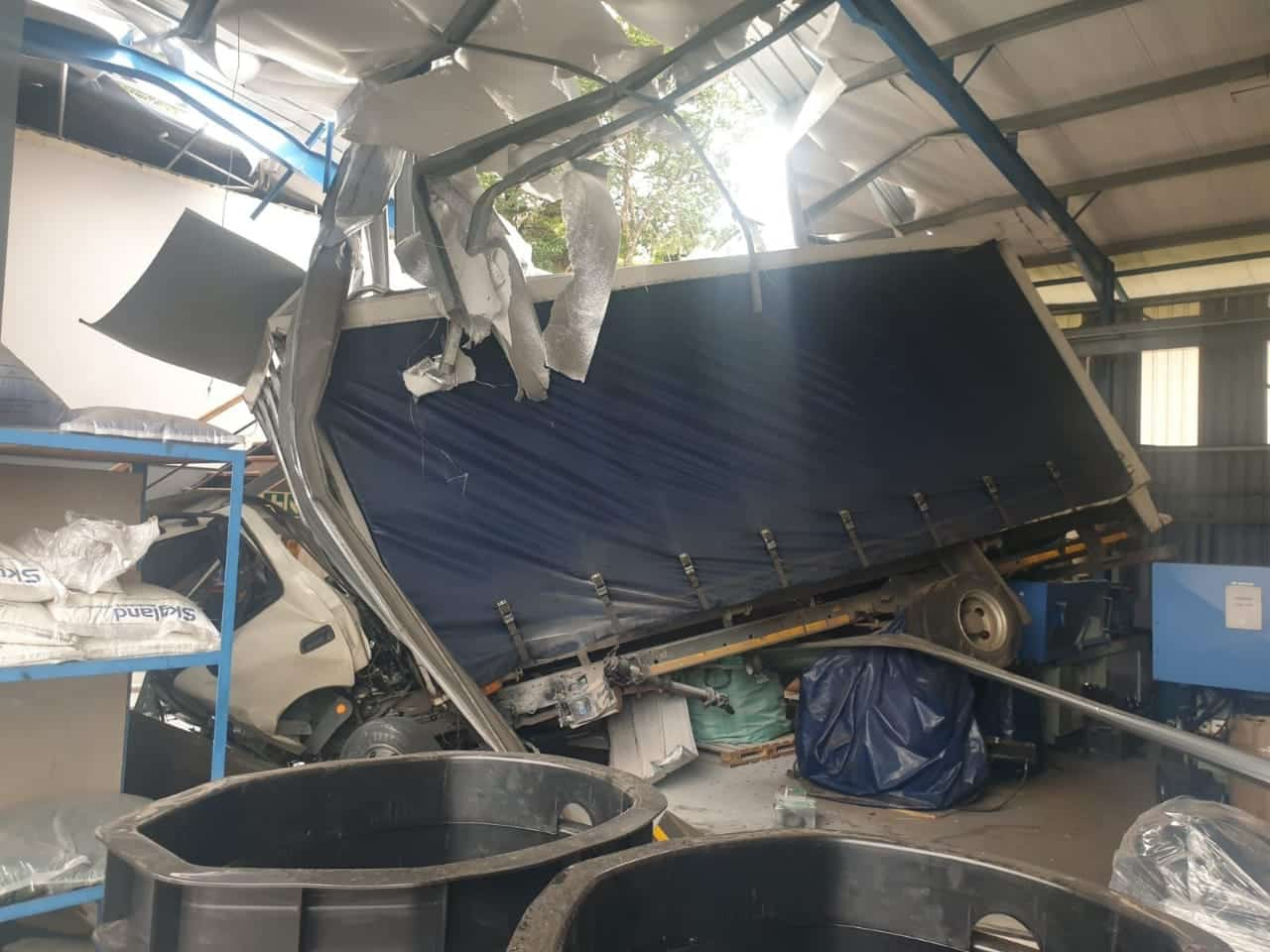 Watch: Truck driver loses control and crash lands on factory roof in Pinetown